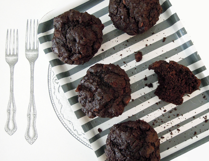 Double chocolate muffins on a white and grey striped napkin.