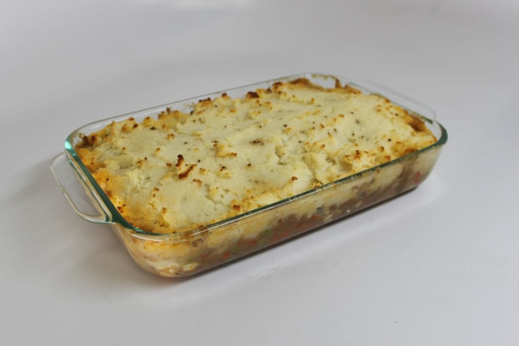 Shepherd's pie in a glass baking dish on the set of Good Eats.