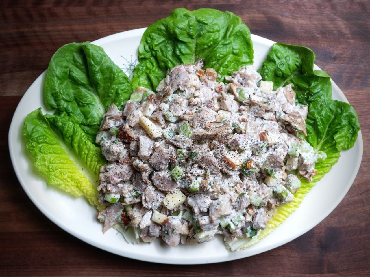 Smoked turkey salad on lettuce cups on white plate